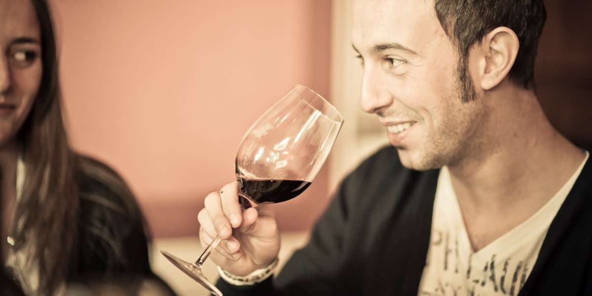 Man drinking red wine from glass