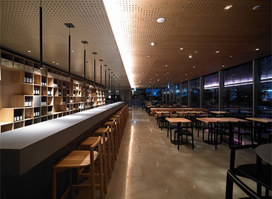 Interior of Penfolds Magill Estate Restaurant Kitchen, with a long baron one side of the room and many tables on the other side